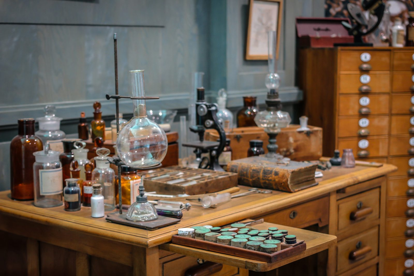 Old science lab with chemical reagents and burner